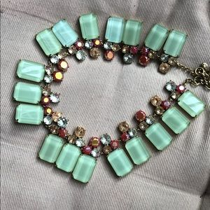 Beautiful teal necklace with red and white details